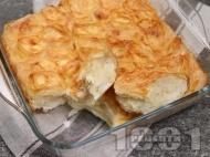 Приготвяне на рецепта Лесна баница на розички с прясно мляко, яйца, сирене, газирана вода и олио